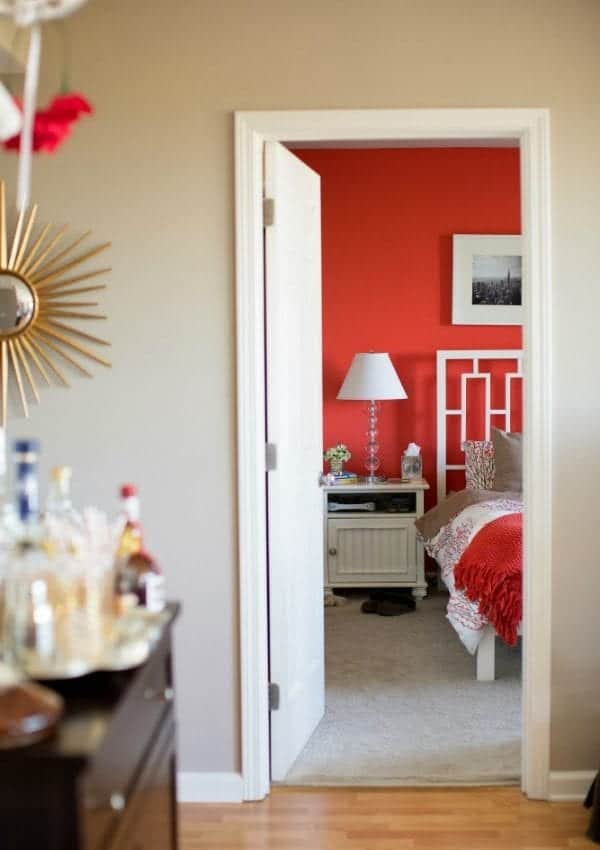 coral bedroom and white bedframe