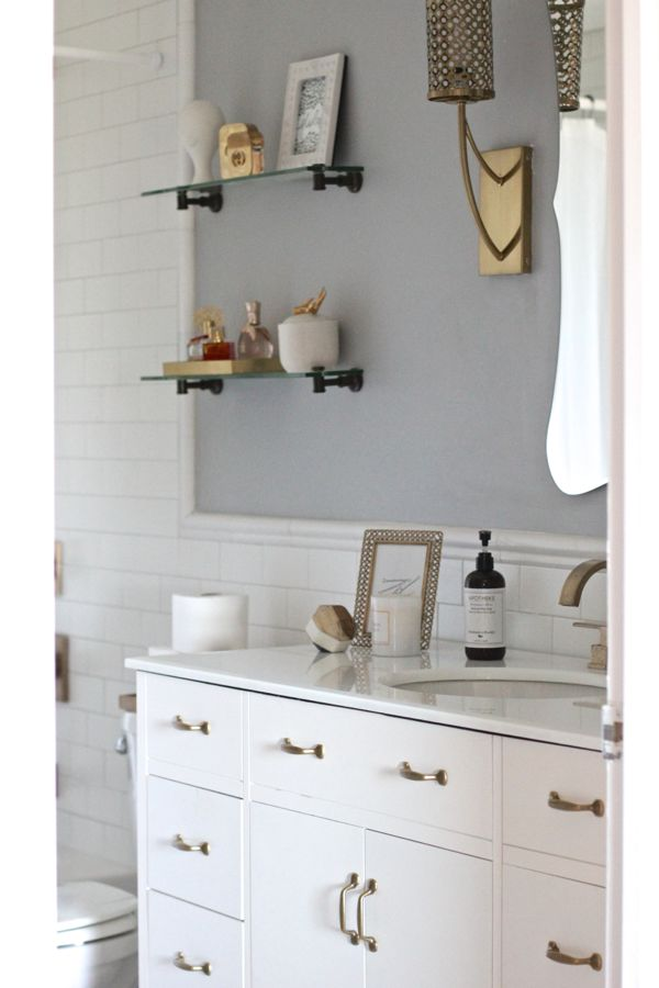 White Subway Tile Bathroom With Brass Fixtures