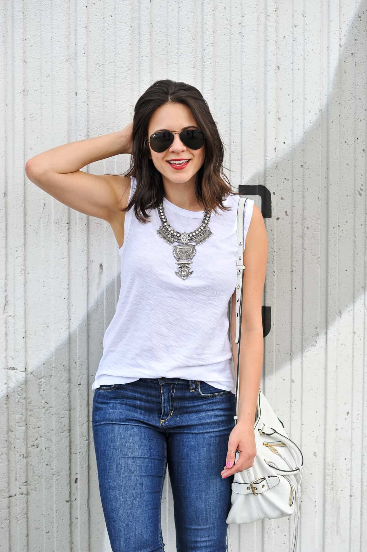 White tee and statement necklace