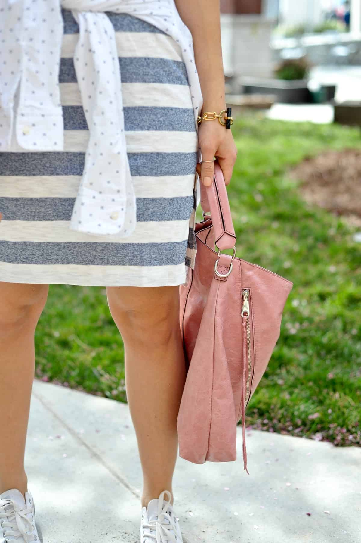 Striped dress and pink leather bag
