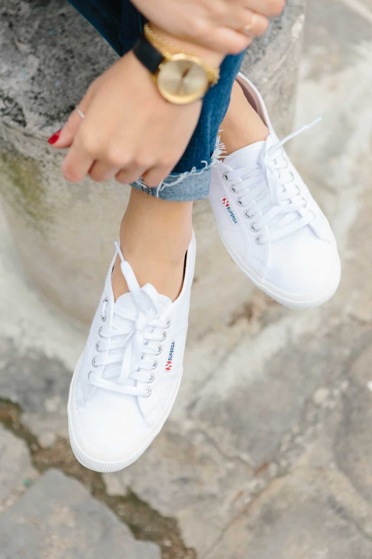 Supergas and jeans with a black and gold watch
