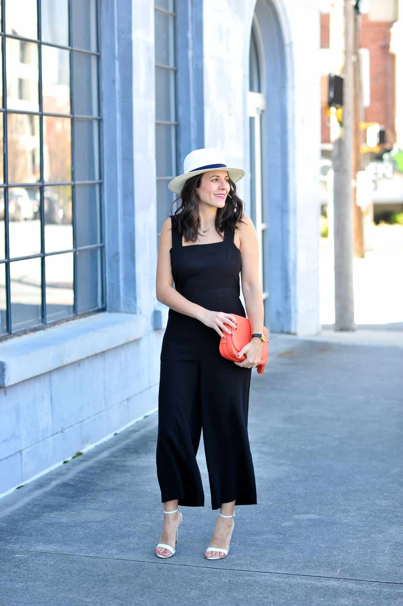 neon bag and black jumpsuit