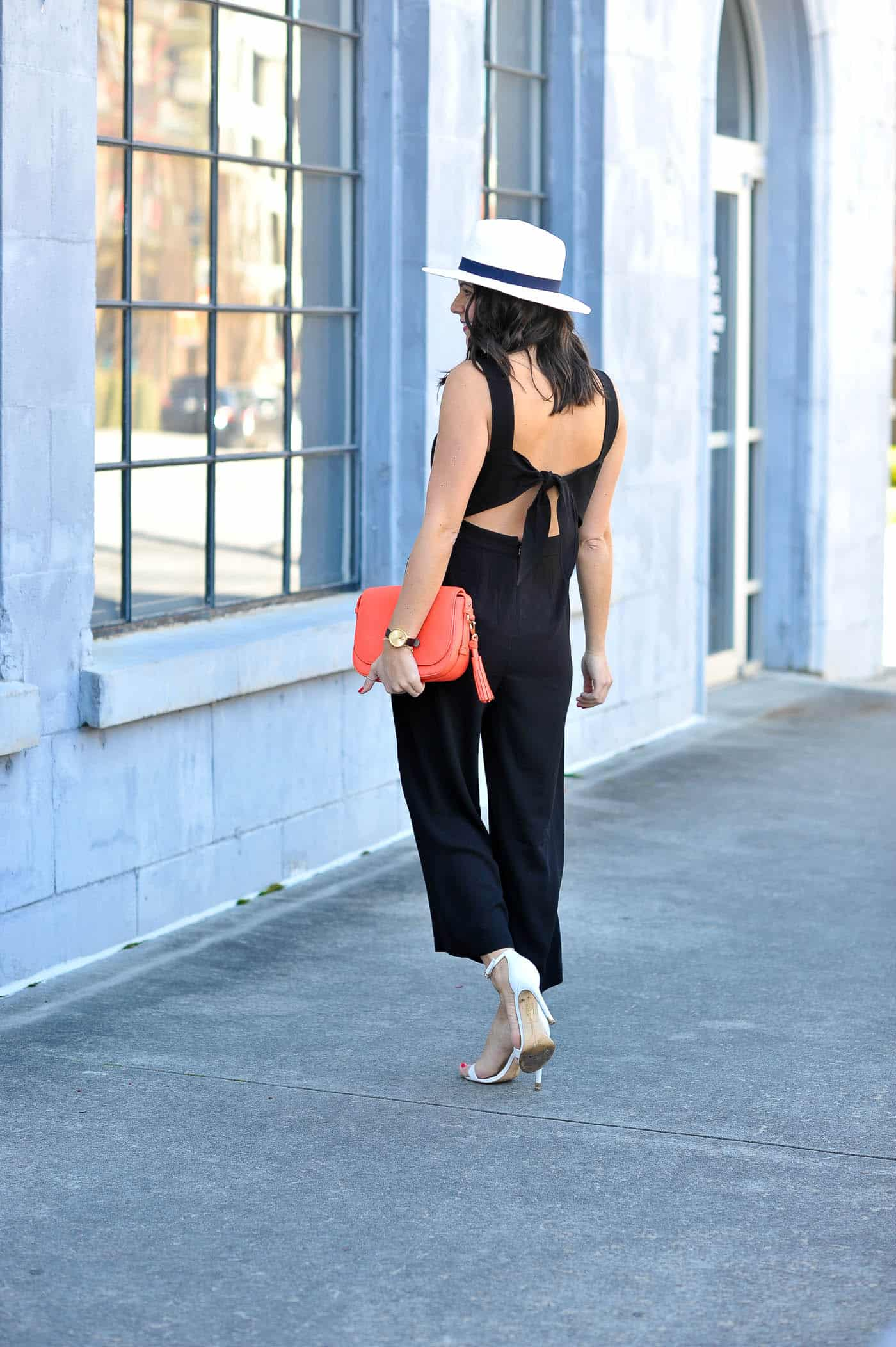 Jessica Camerata styling a black Madewell jumpsuit