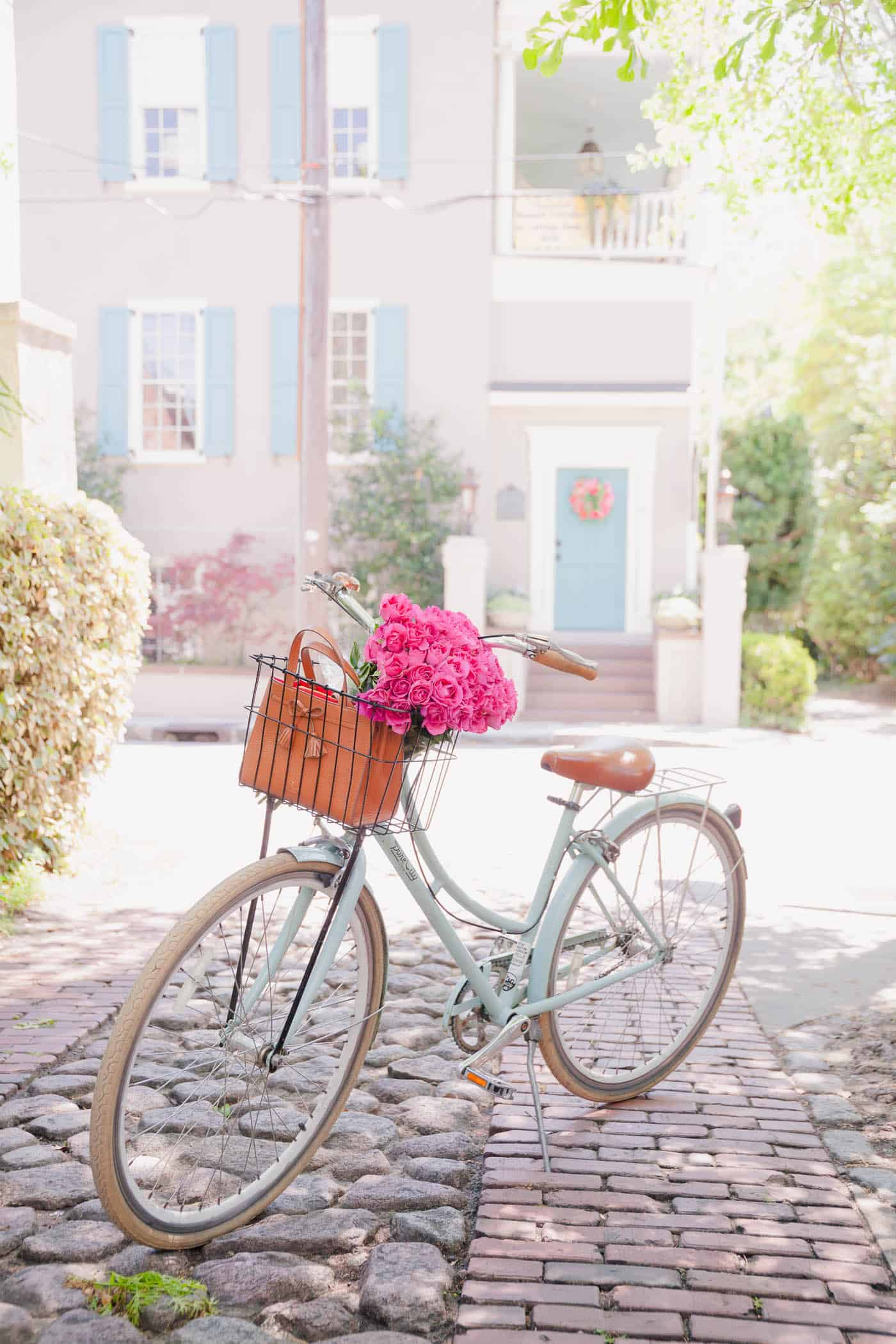 Charleston, things to do in Charleston, the best places to eat in Charleston - pastel bike with flowers in the basket in charleston on cobblestone
