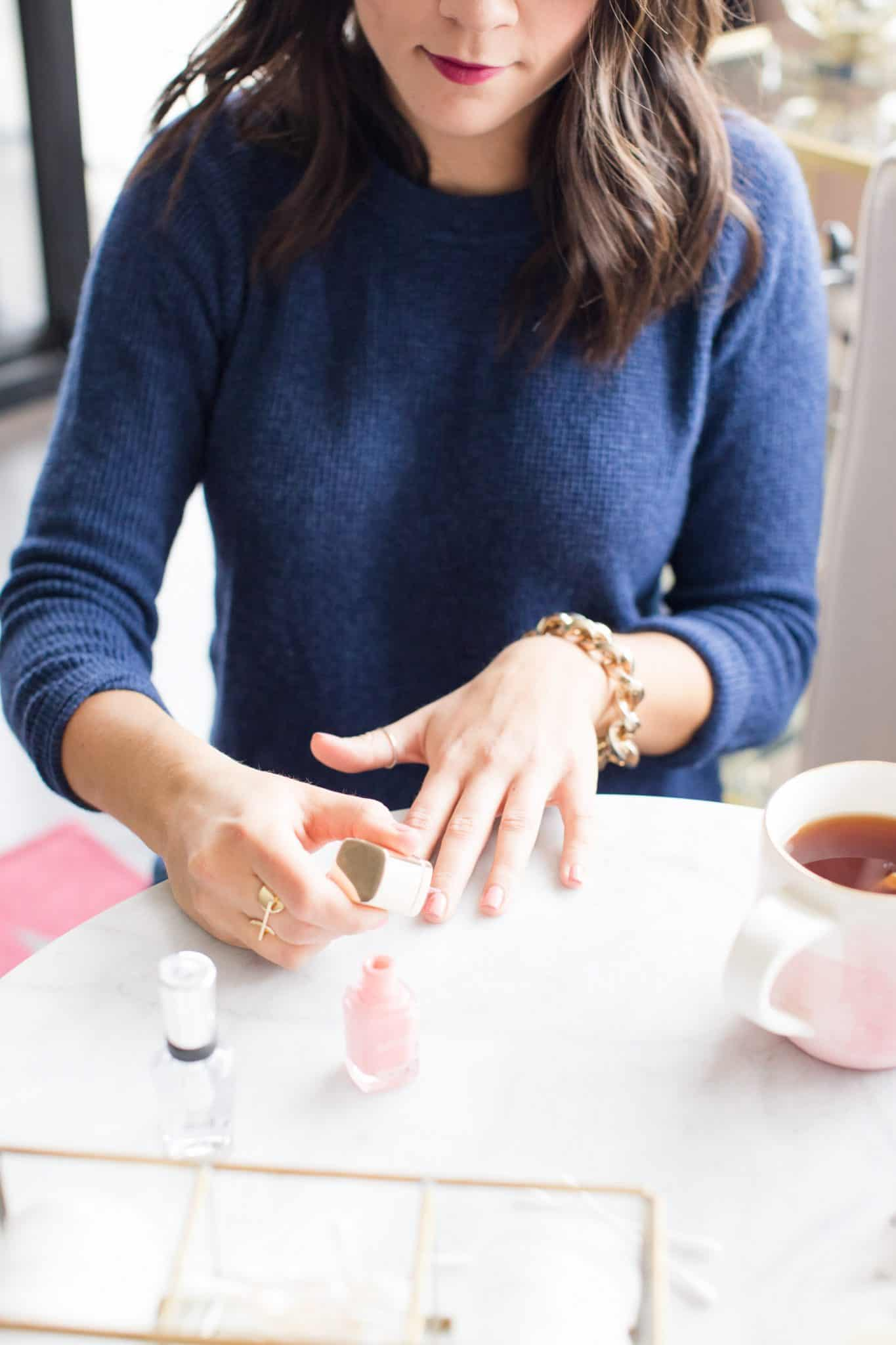 Jessica Camerata paints her nails at home
