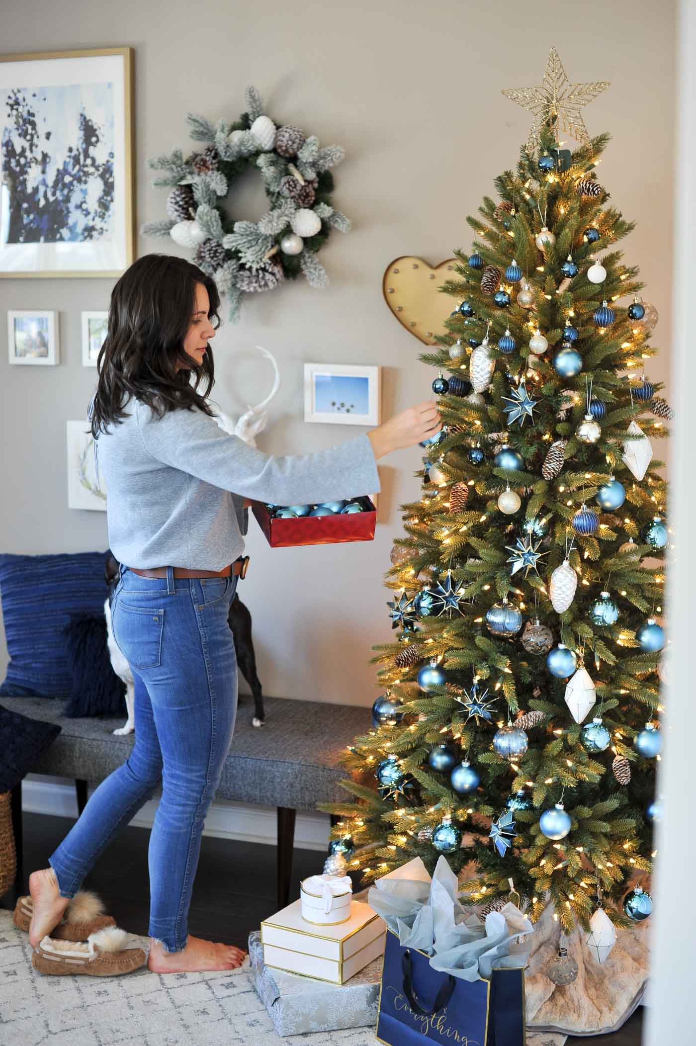 while blasting some classic christmas songs oh and that good ol mariah carey i started to decorate my tree after placing all the blue ornaments i could - Blue Christmas Trees