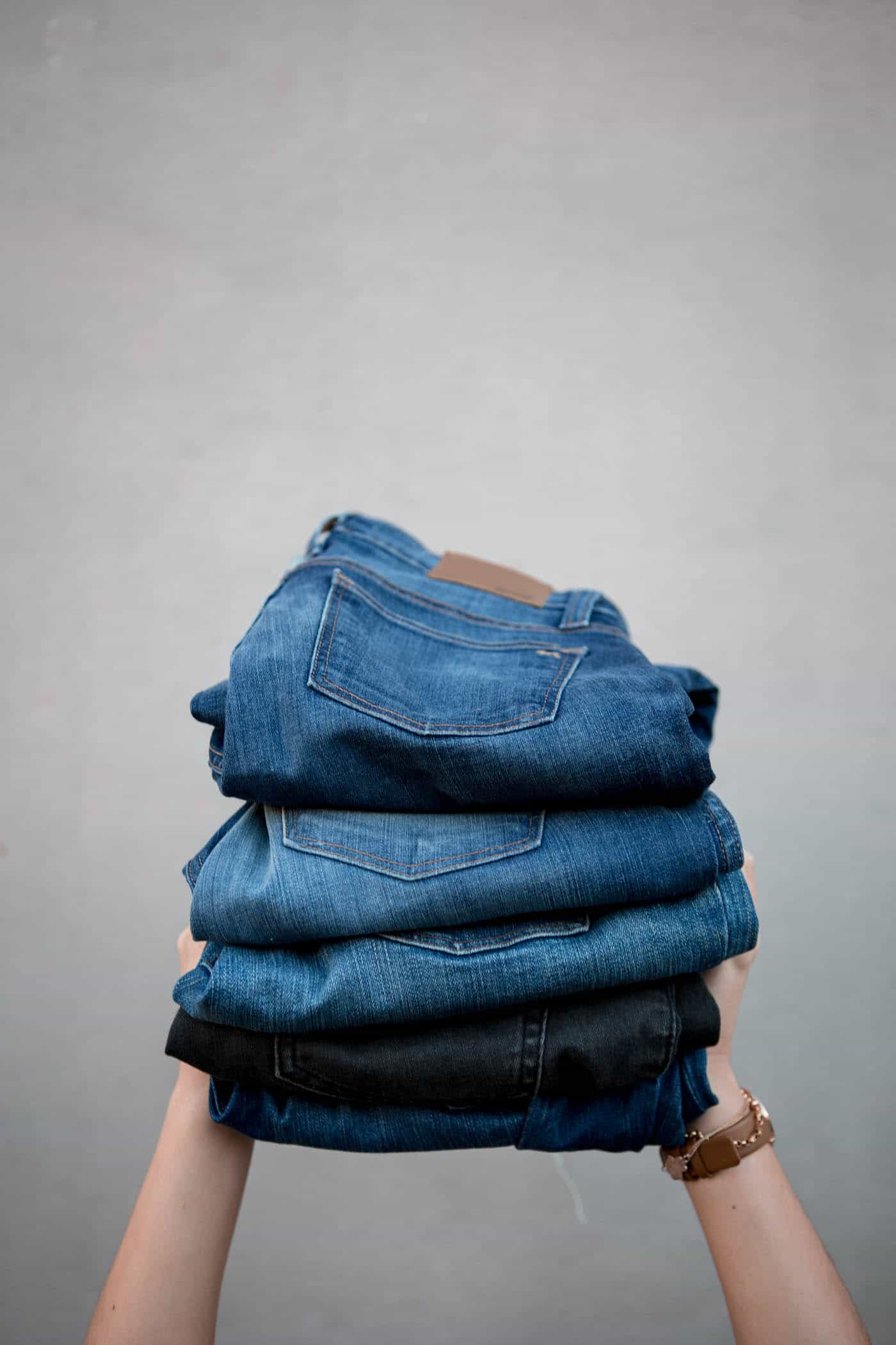 stacked jeans, folded jeans, how to care for your jeans