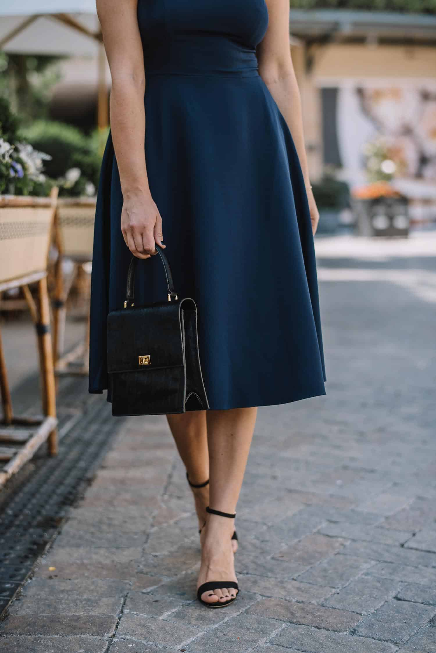 navy midi dress and black accessories