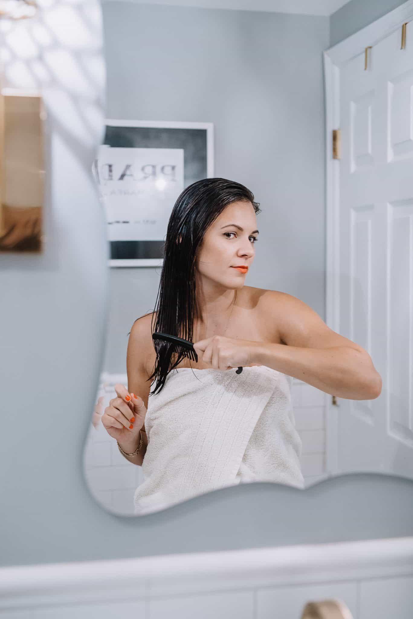 Jessica Camerata brushing her hair after a shower