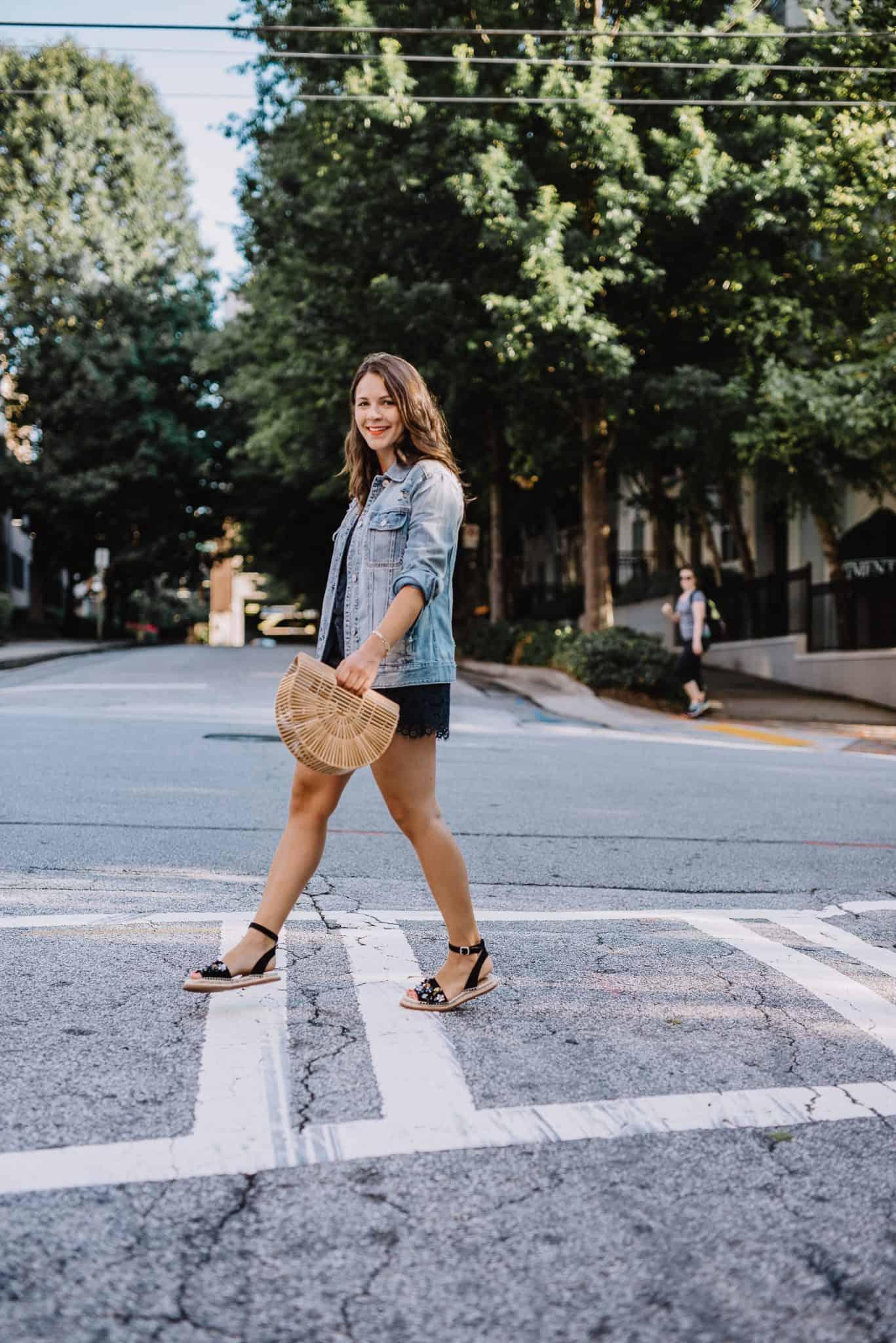 jessica camerata walking across the street in a denim jacket