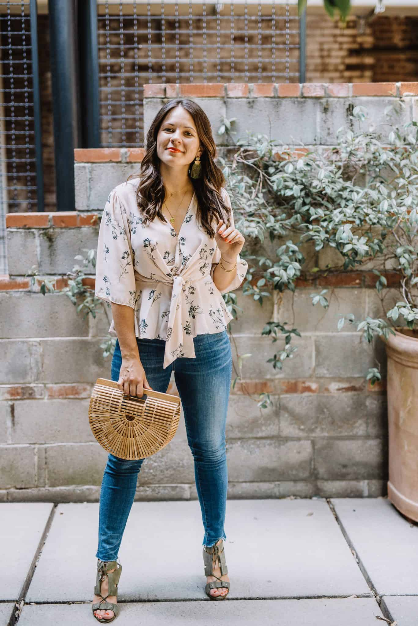 Dressing up jeans with a knotted wrap top