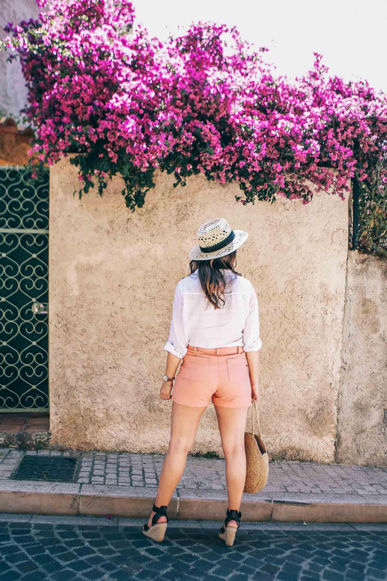 white button down and peach shorts