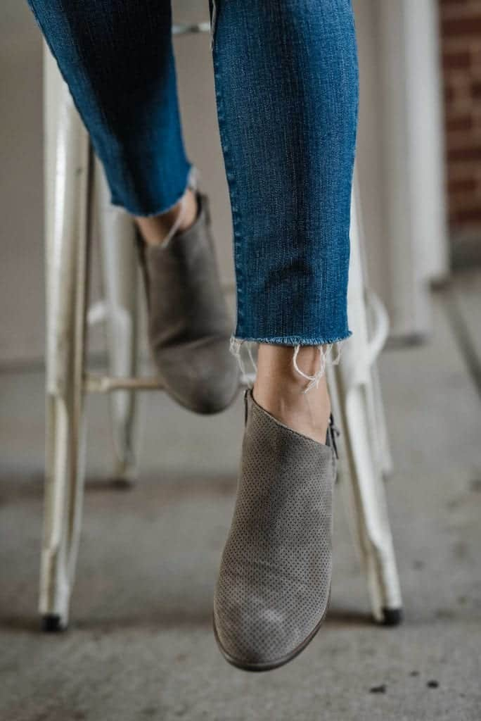 neutral flat booties with jeans