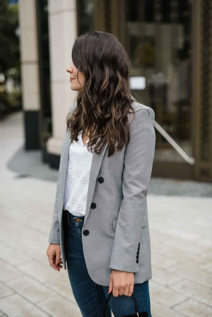 a woman modeling and talking about How To Wear Plaid Blazers