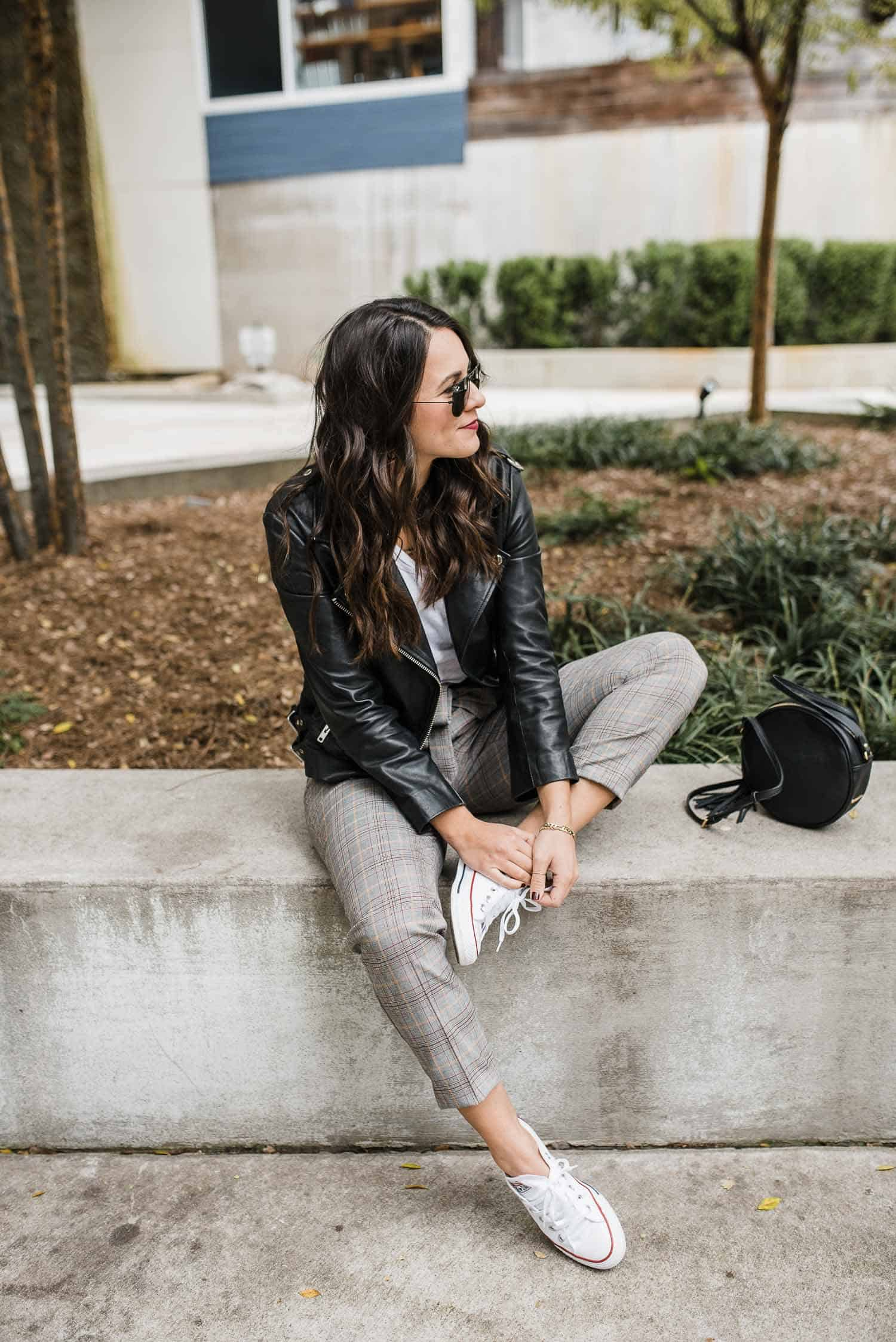 Express Trousers • Caslon White Tee • Leather Jacket • Converse • Ray-Ban Aviators • Beautycounter Lipstick in Girls' Night • Gigi New York Circle Bag