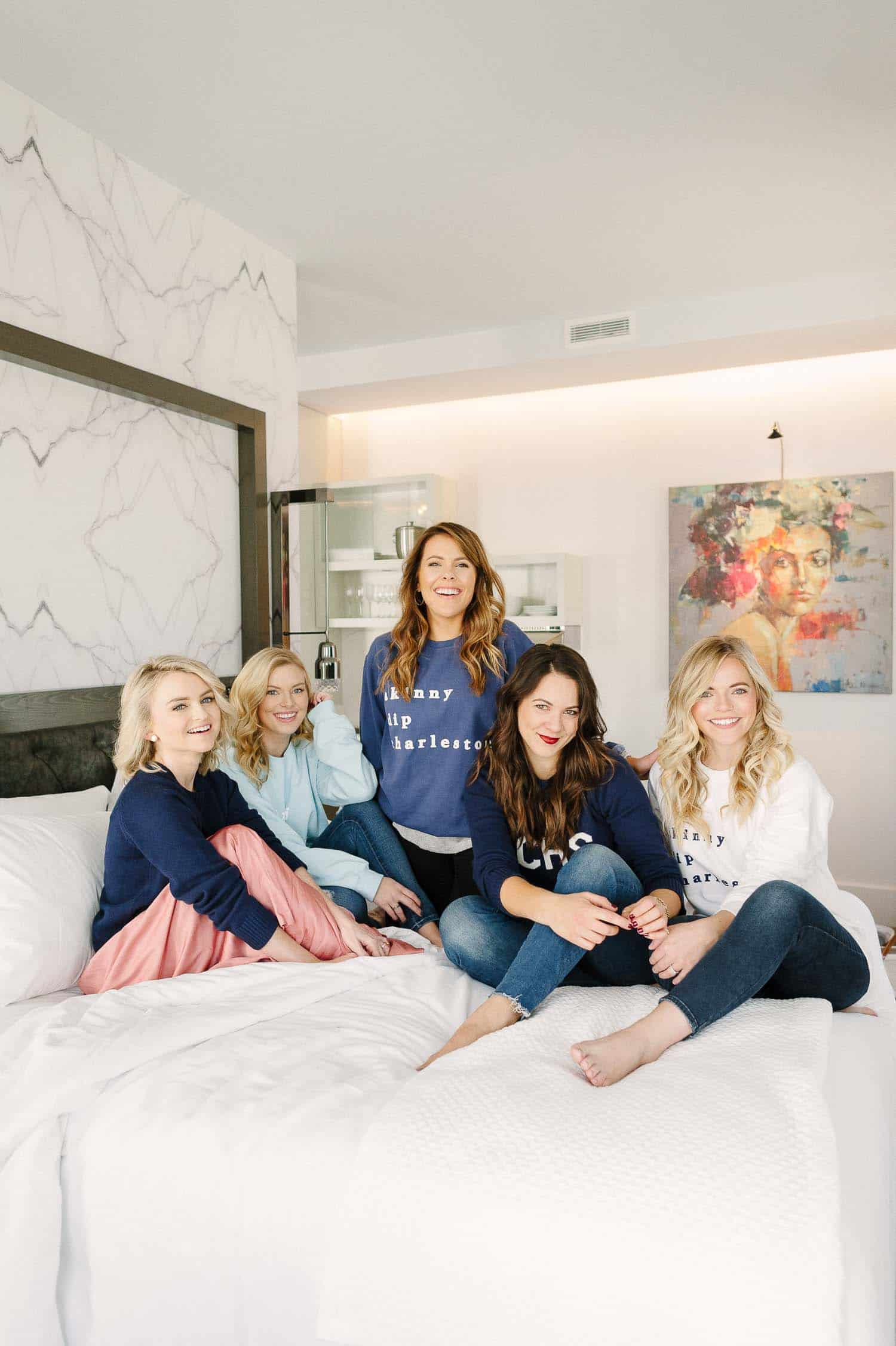 Girls trip ideas, where to stay in Charleston, friends jumping on the bed - My Style Vita