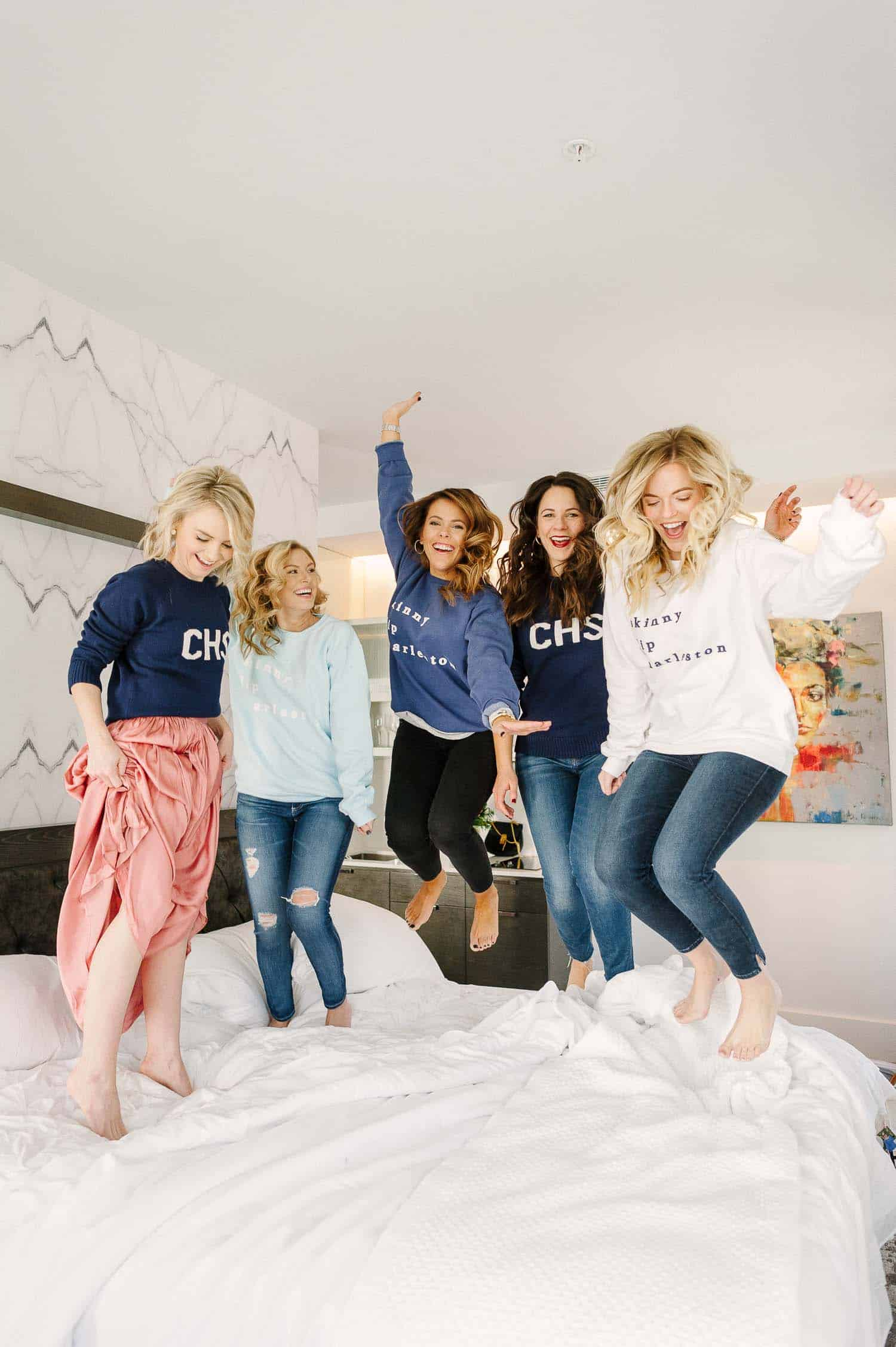 Reasons to take a girls trip, friends jumping on bed