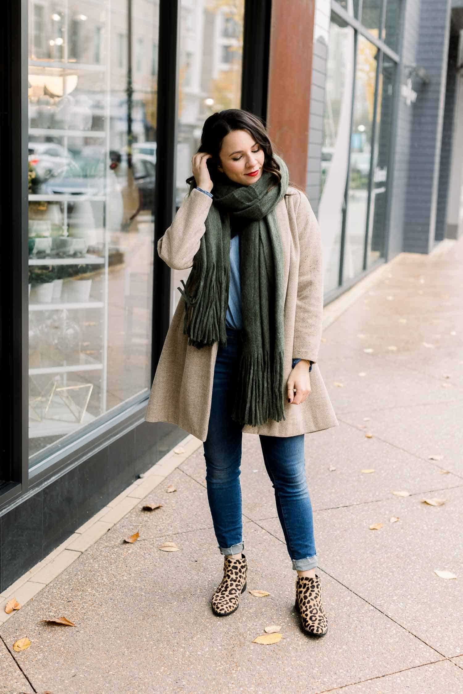 Jessica's Outfit: Madewell Coat  • Madewell Jeans • Anthropologie Fringe Scarf • Steven Leopard Booties - ON SALE! • Beautycounter Lipstick in 'Girls' Night'