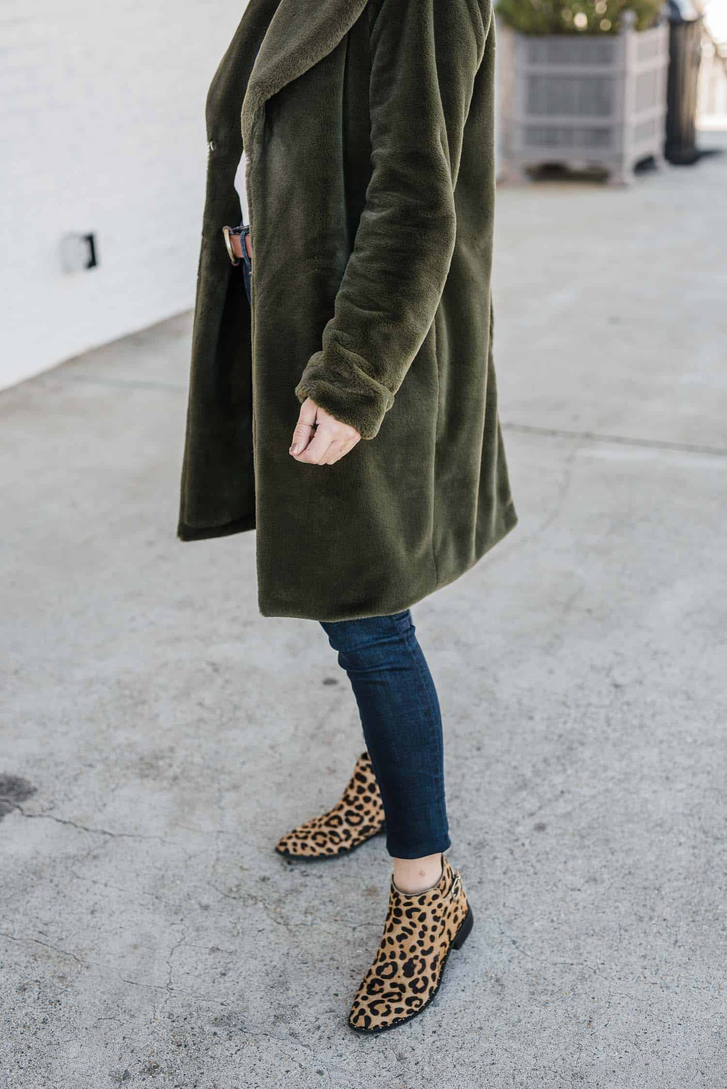 Green faux fur coat, jeans and leopard boots