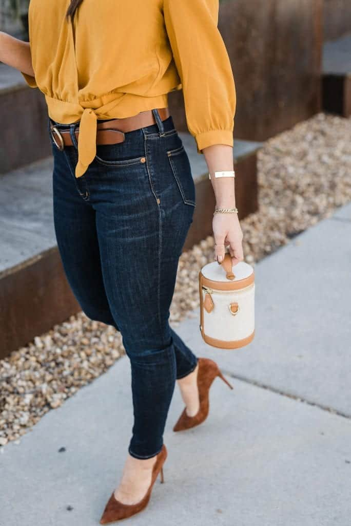 mustard silk top, jeans, bag and heels