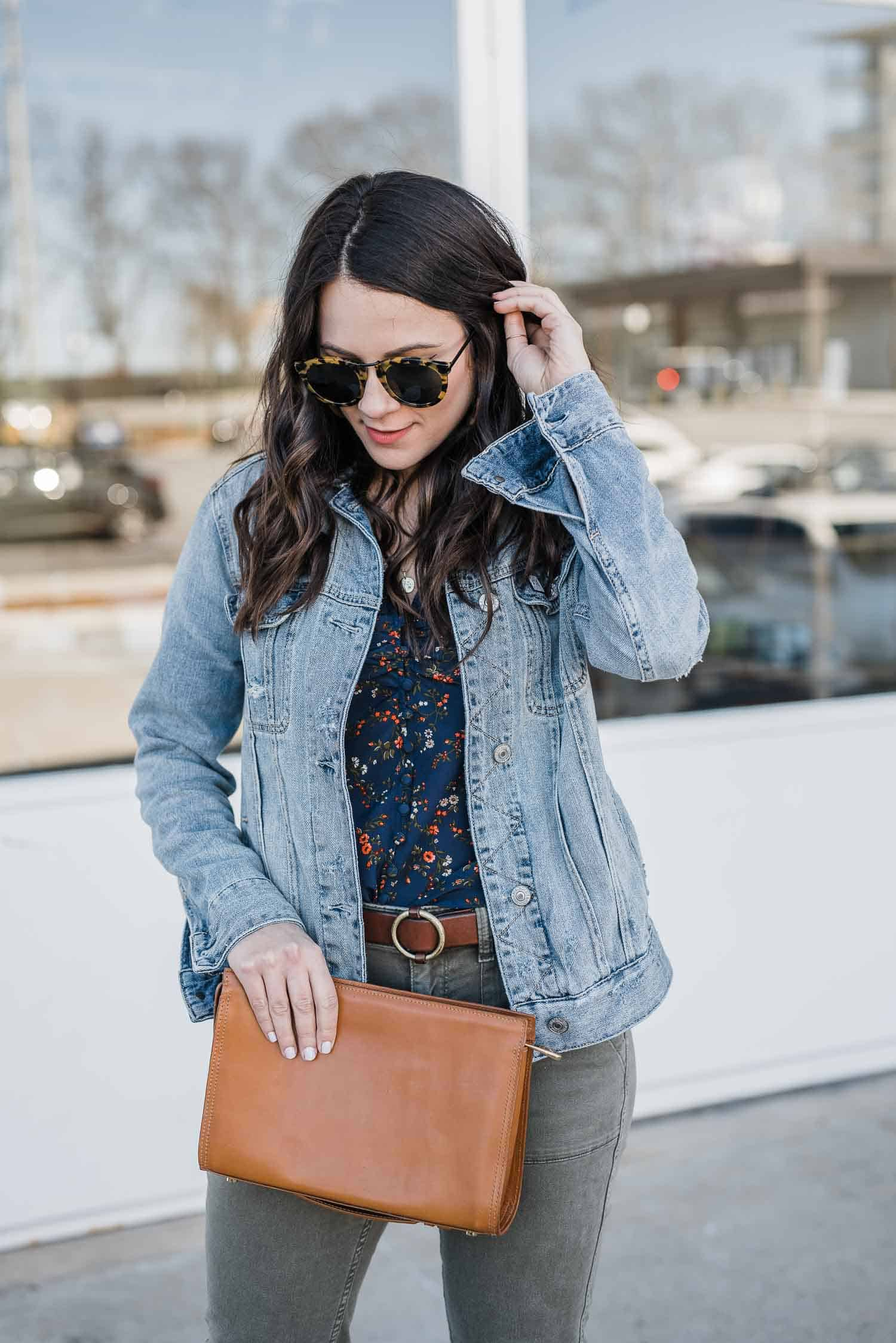 Jessica Camerata is featuring a  denim jacket with brown leather bag