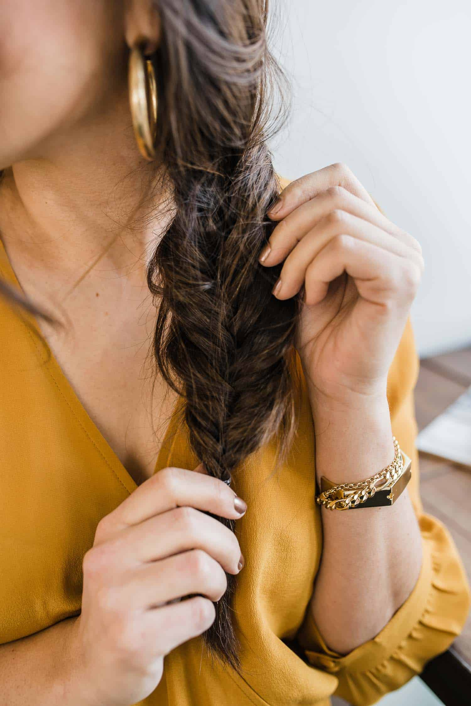 Jessica is featuring a Mustard Top, Gold Bracelet and Braided Hair