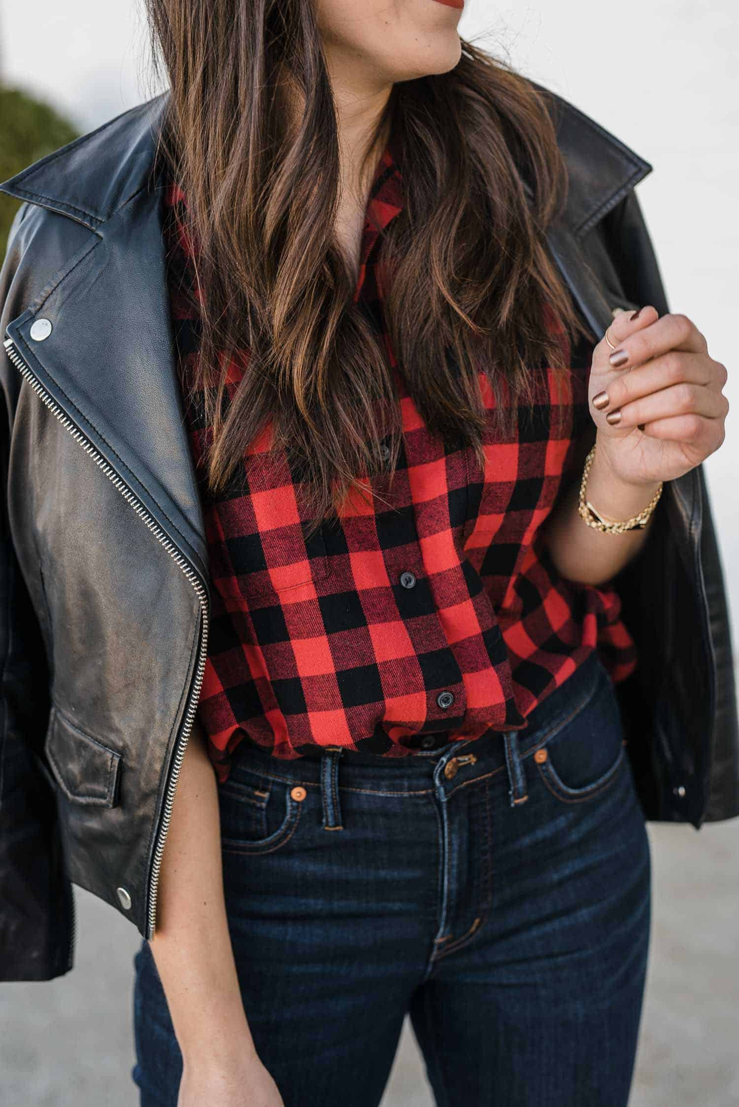 Black leather jacket, plaid shirt and jeans