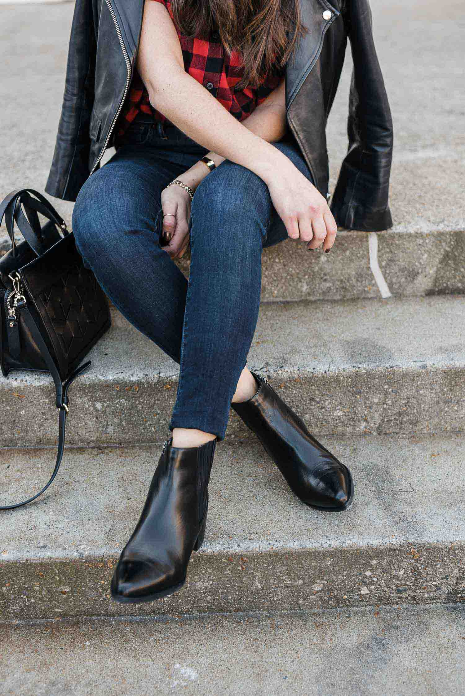 black leather booties and jeans