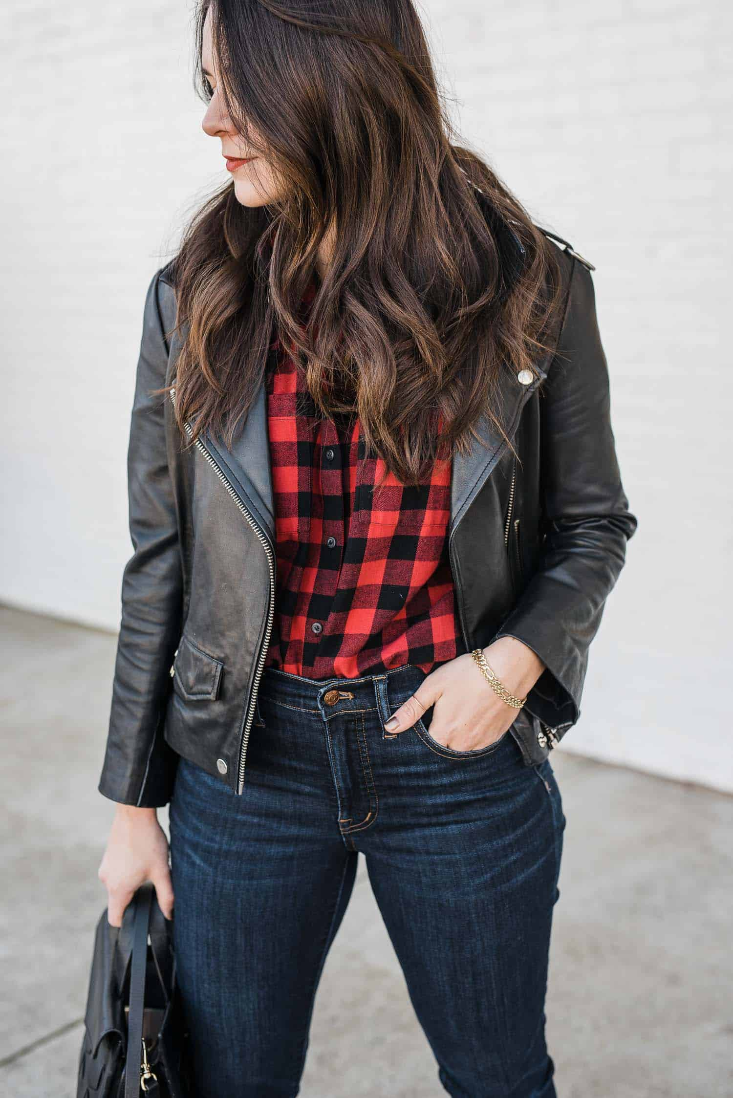 JESSICA CAMERATA OUTFIT DETAILS: MADEWELL PLAID SHIRT, LEATHER JACKET,  MADEWELL JEANS AND WELDEN BAG