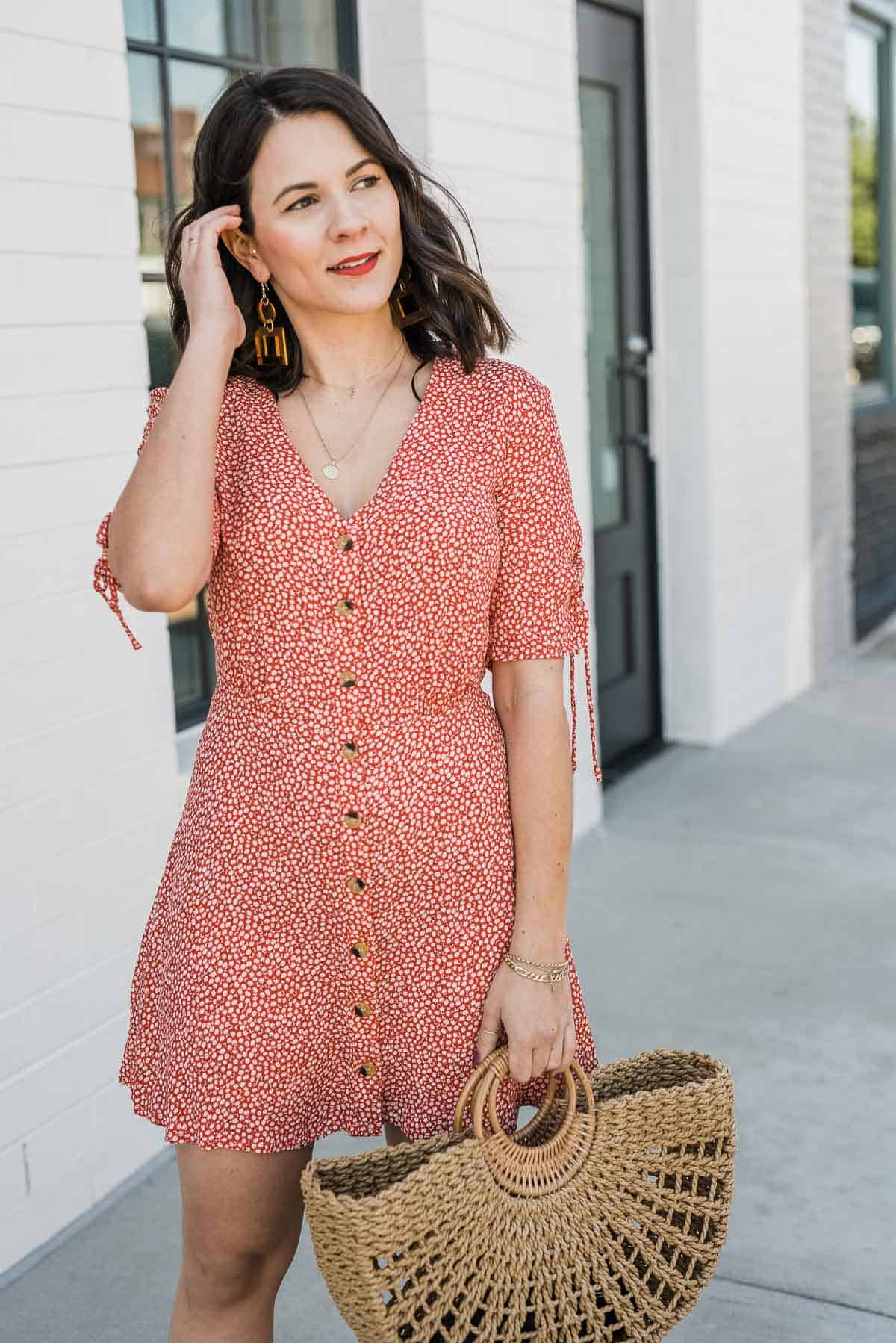 Jessica Camerata is wearing a red printed v-neck dress from H&M