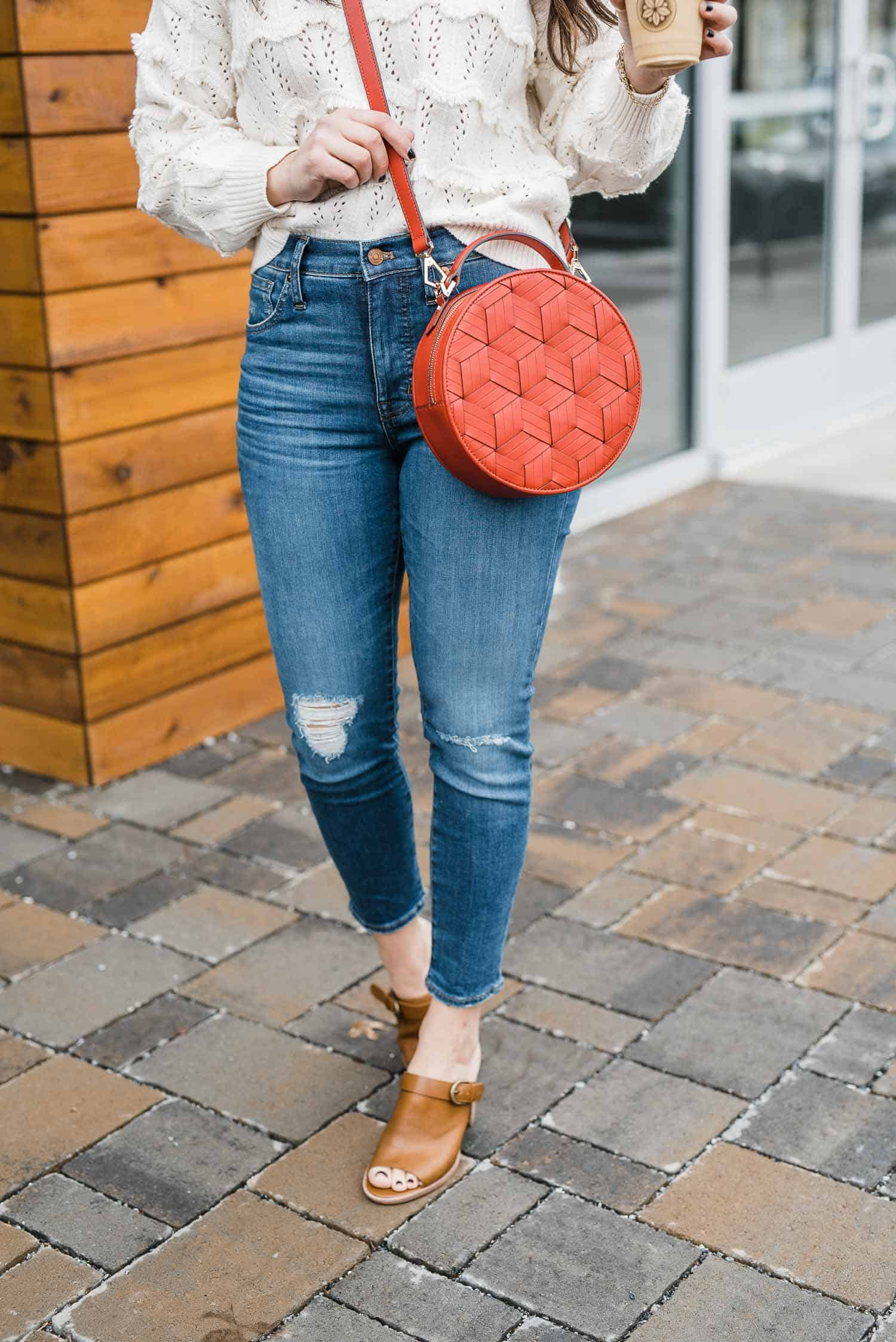 Jessica Camerata is featuring a welden red leather circle bag