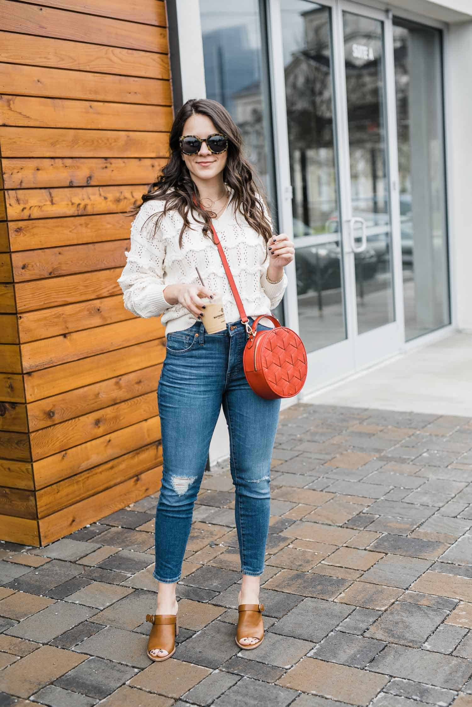Jessica Camerata is wearing a cream spring sweater, Madewell jeans