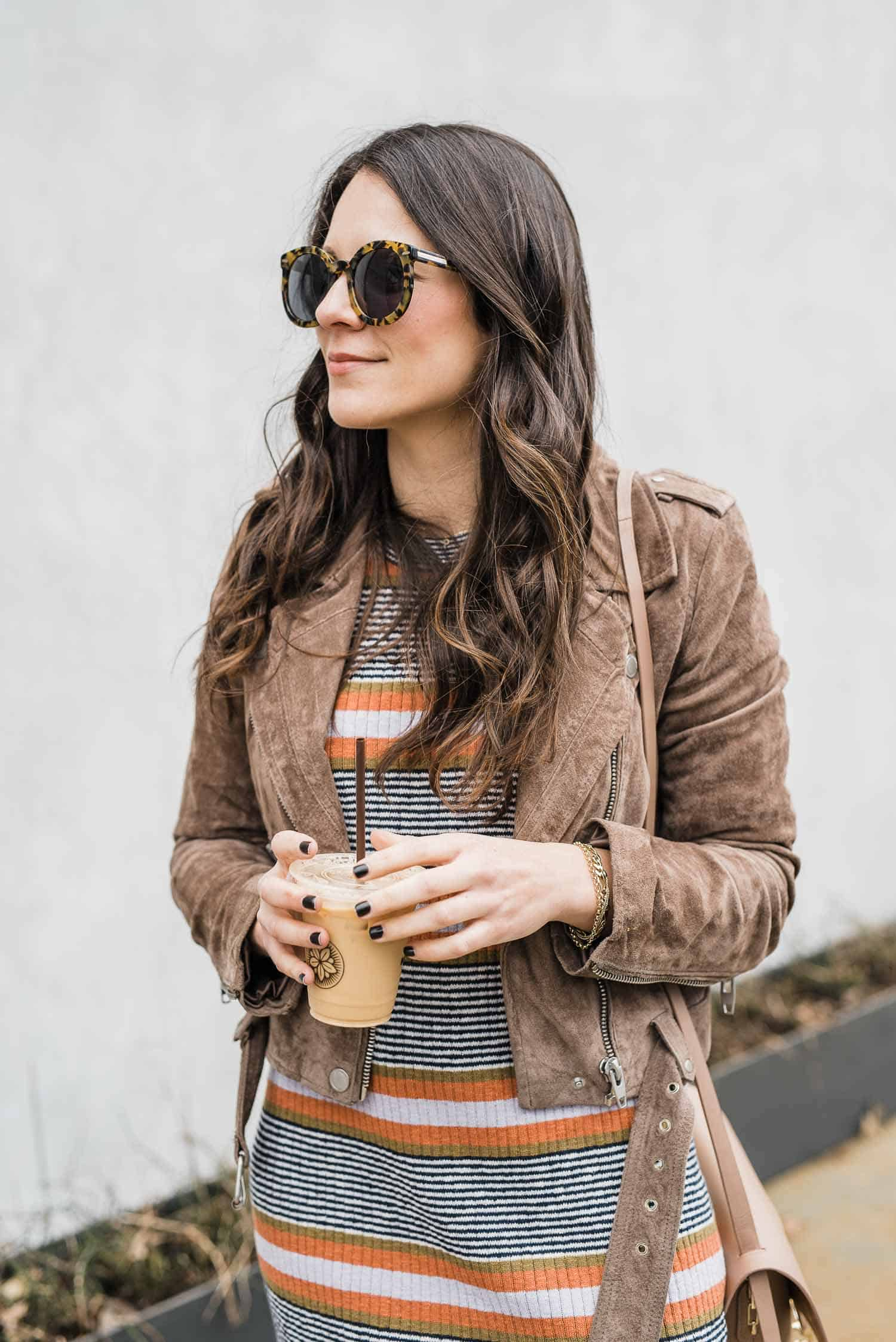 suede moto jacket, striped dress, sunglasses look