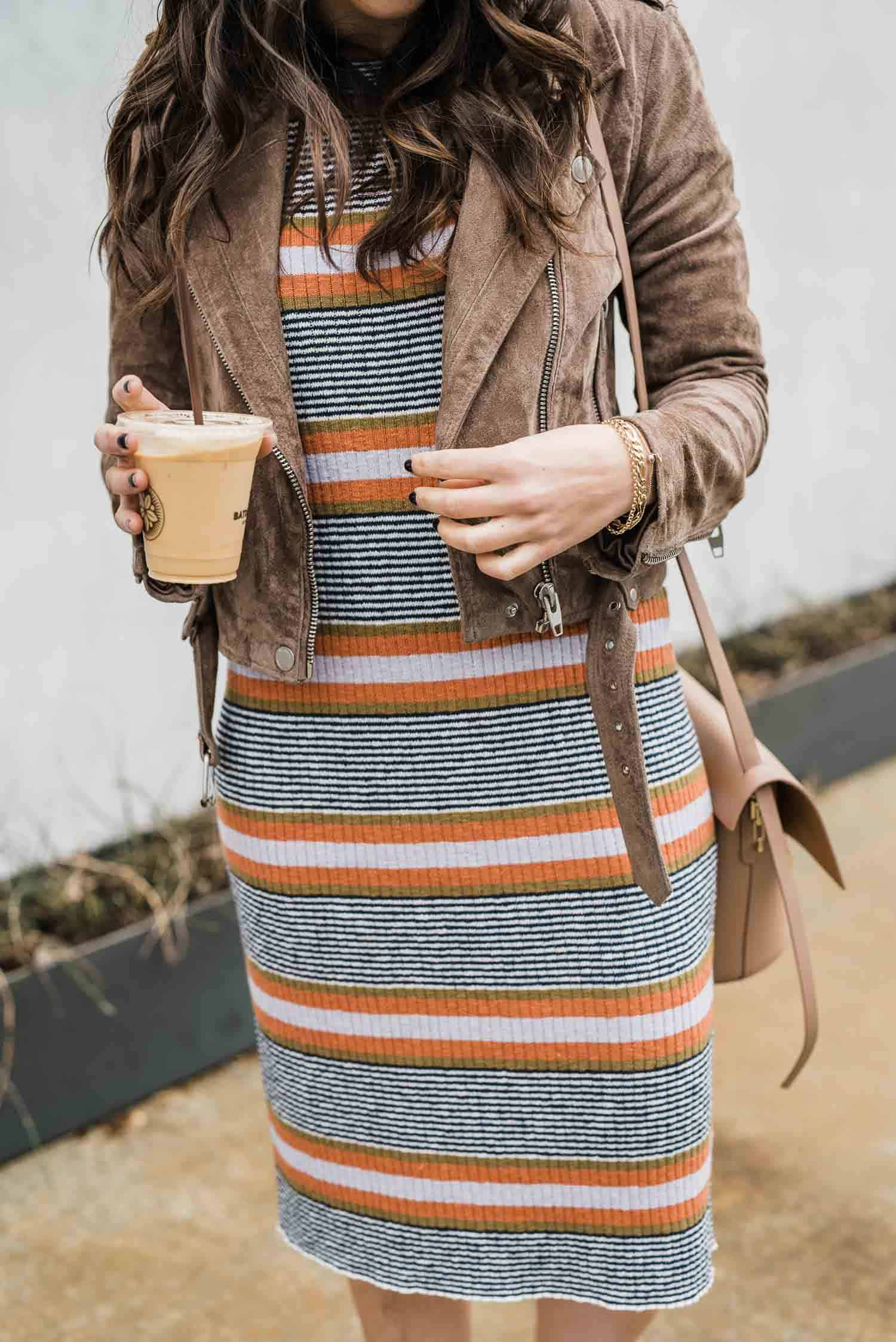 striped sweater dress with a suede jacket