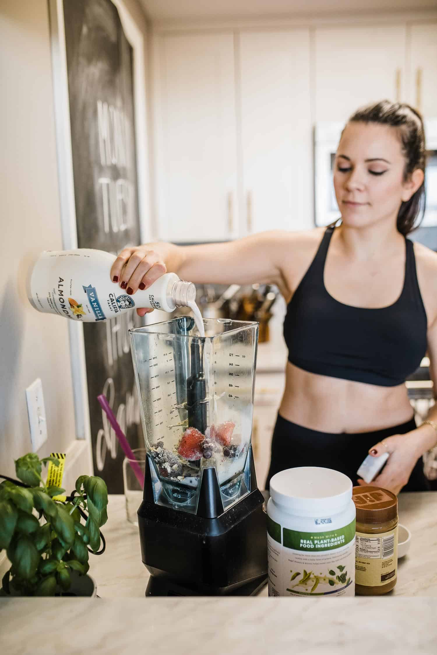 Jessica Camerata is making a breakfast smoothie with almond milk