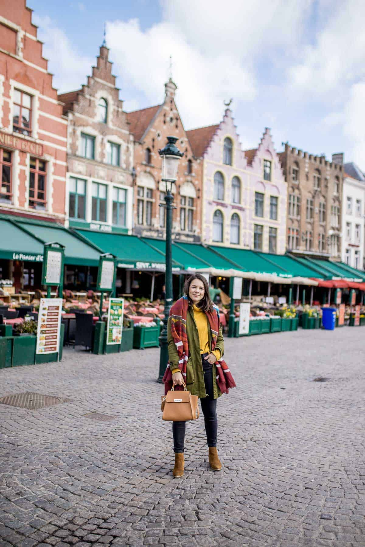 Jessica is at the Market Square of Bruges