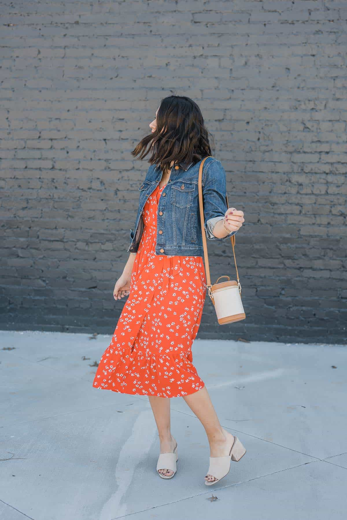 denim jacket with a red midi dress for summer