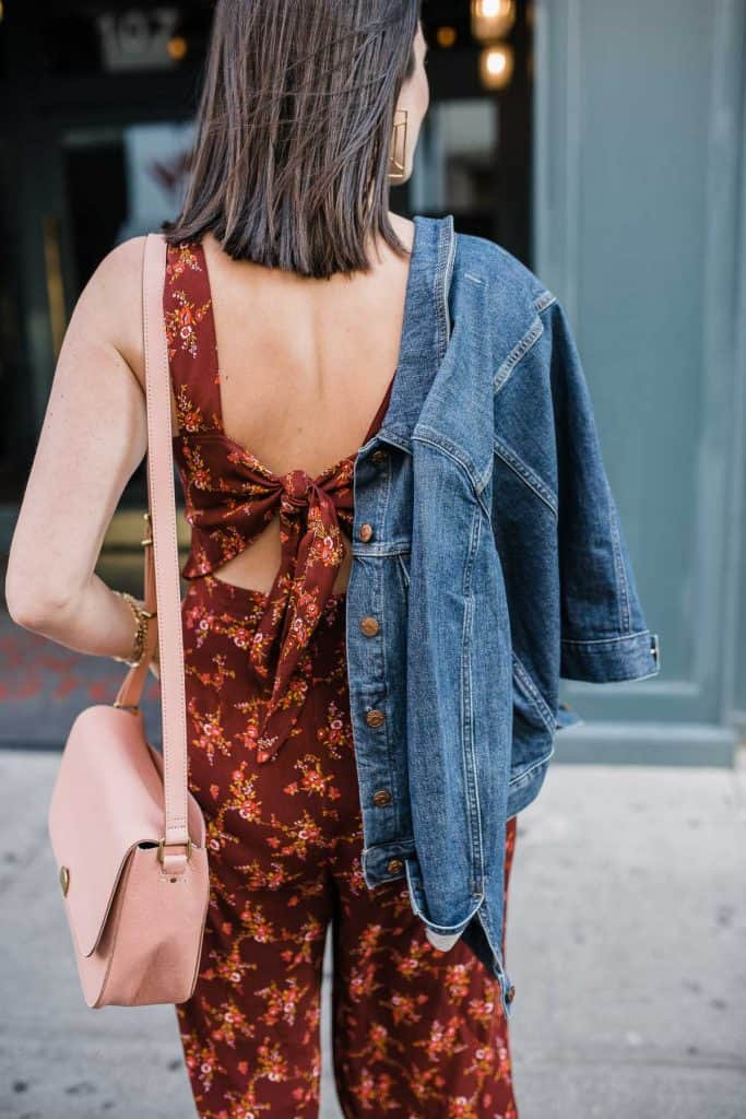 bow back floral jumpsuit, blush bag and denim jacket