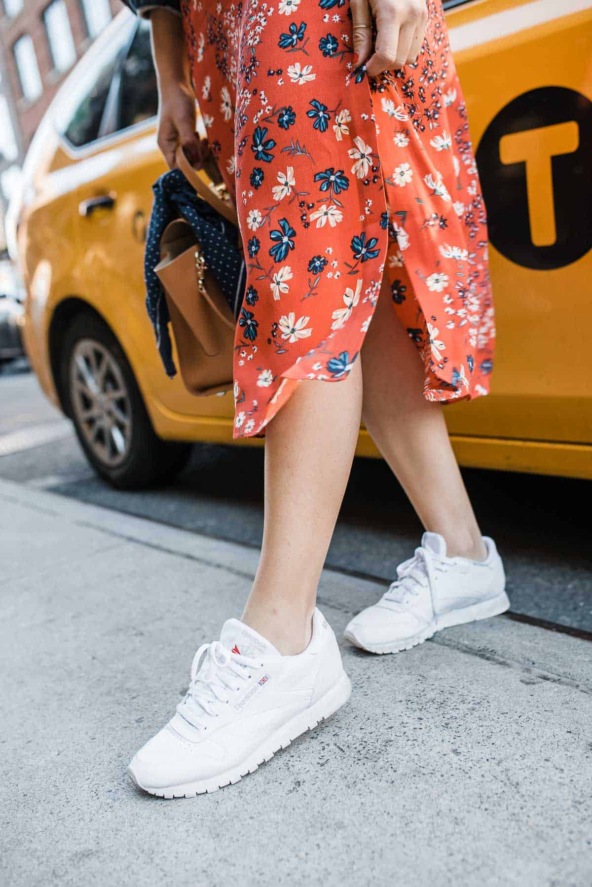 floral skirt and white sneakers outfit.