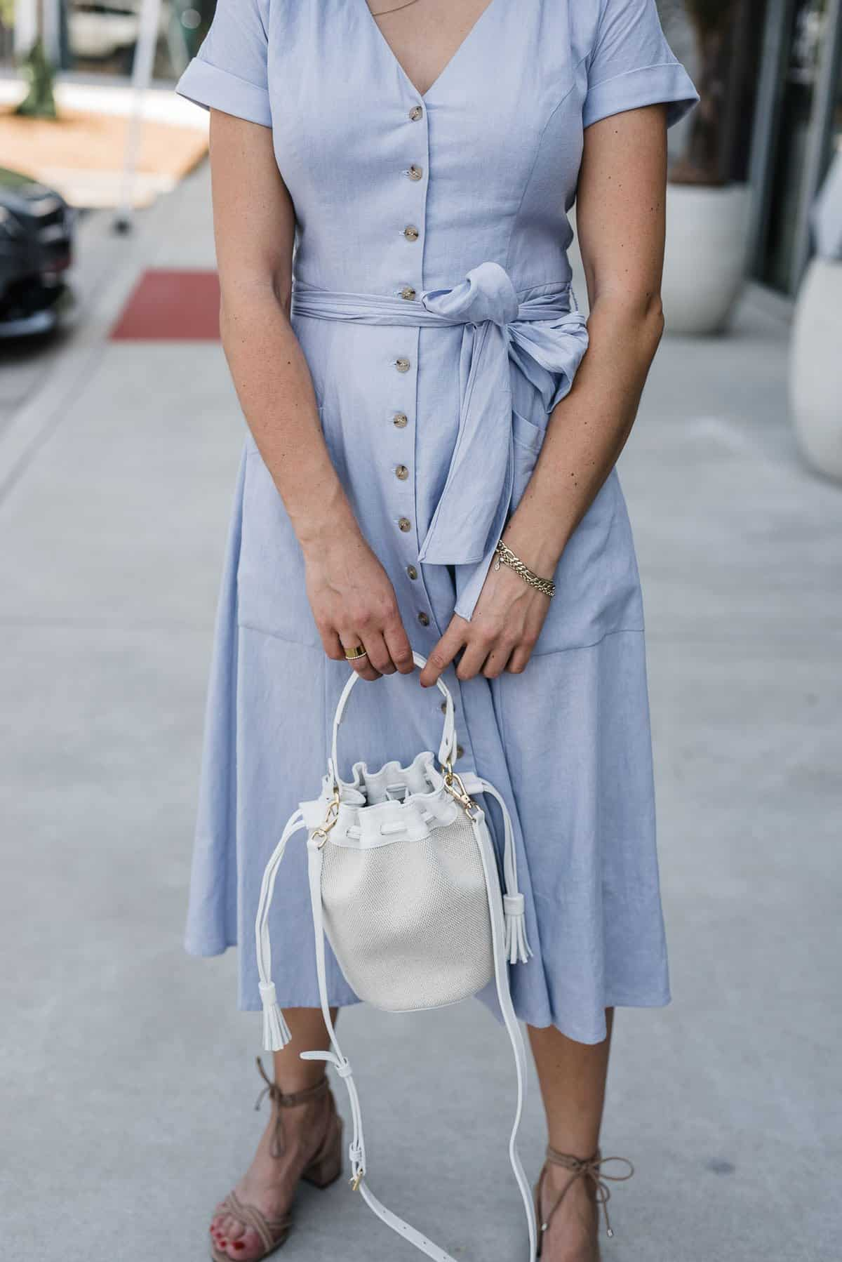 lilac dress with a bucket bag