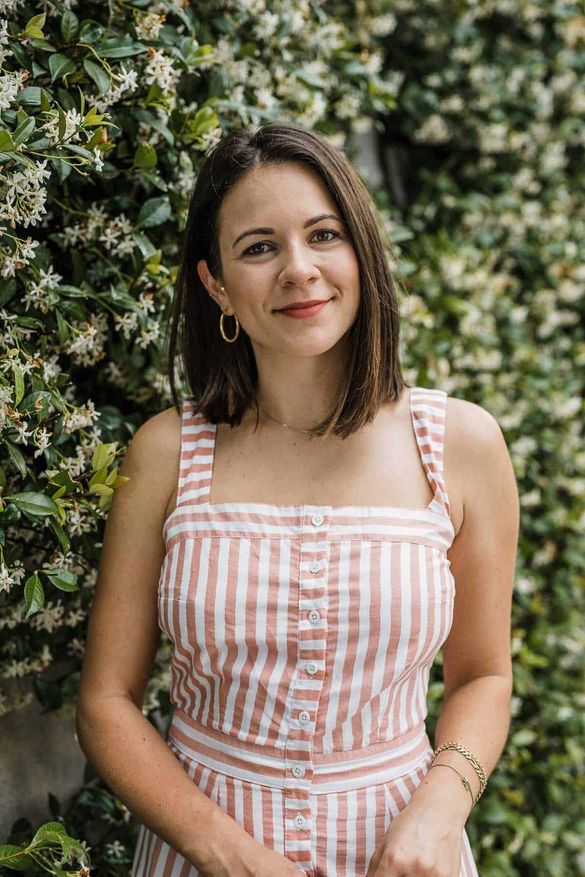 Jessica Camerata is wearing a striped maxi dress