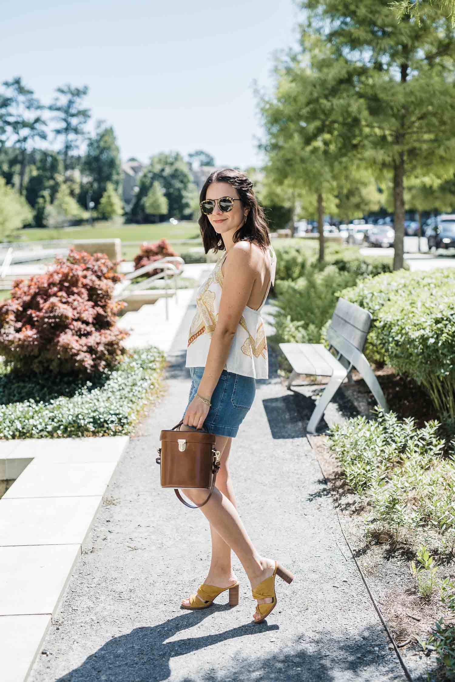OUTFIT DETAILS: FREE PEOPLE CABANA TOP • MADEWELL CHASE SHORTS • MADEWELL GESINE MULES • BRAHMIN BAG • KAREN WALKER SUNGLASSES • SHEIN HAIR CLIPS