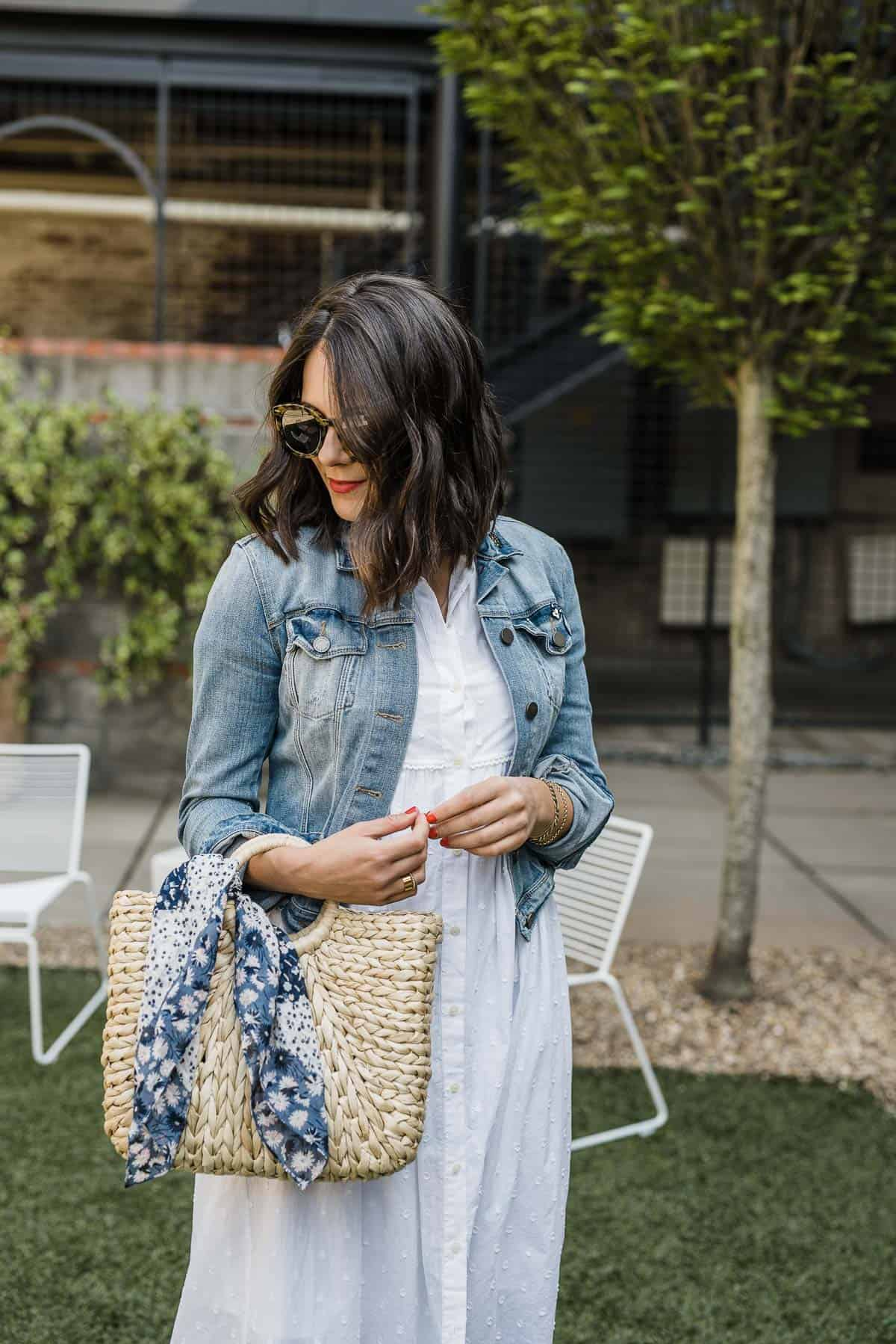 Jessica is wearing  The Jean Jacket in Pinter Wash and Clipdot Midi Shirtdress from Madewell