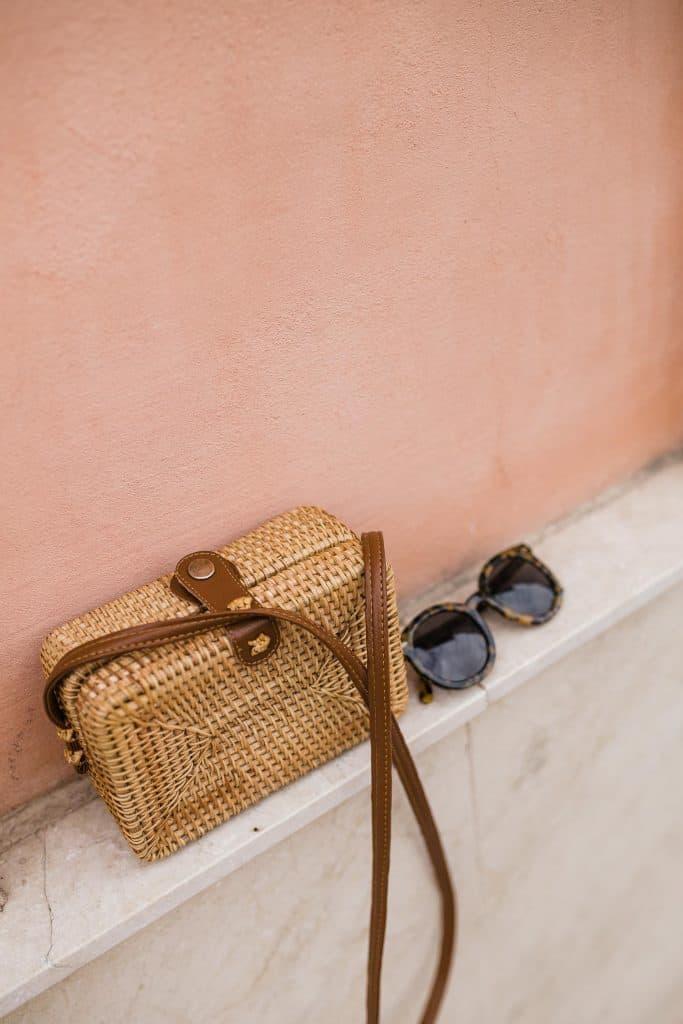 Amazon Rattan Crossbody Bag and sunglasses