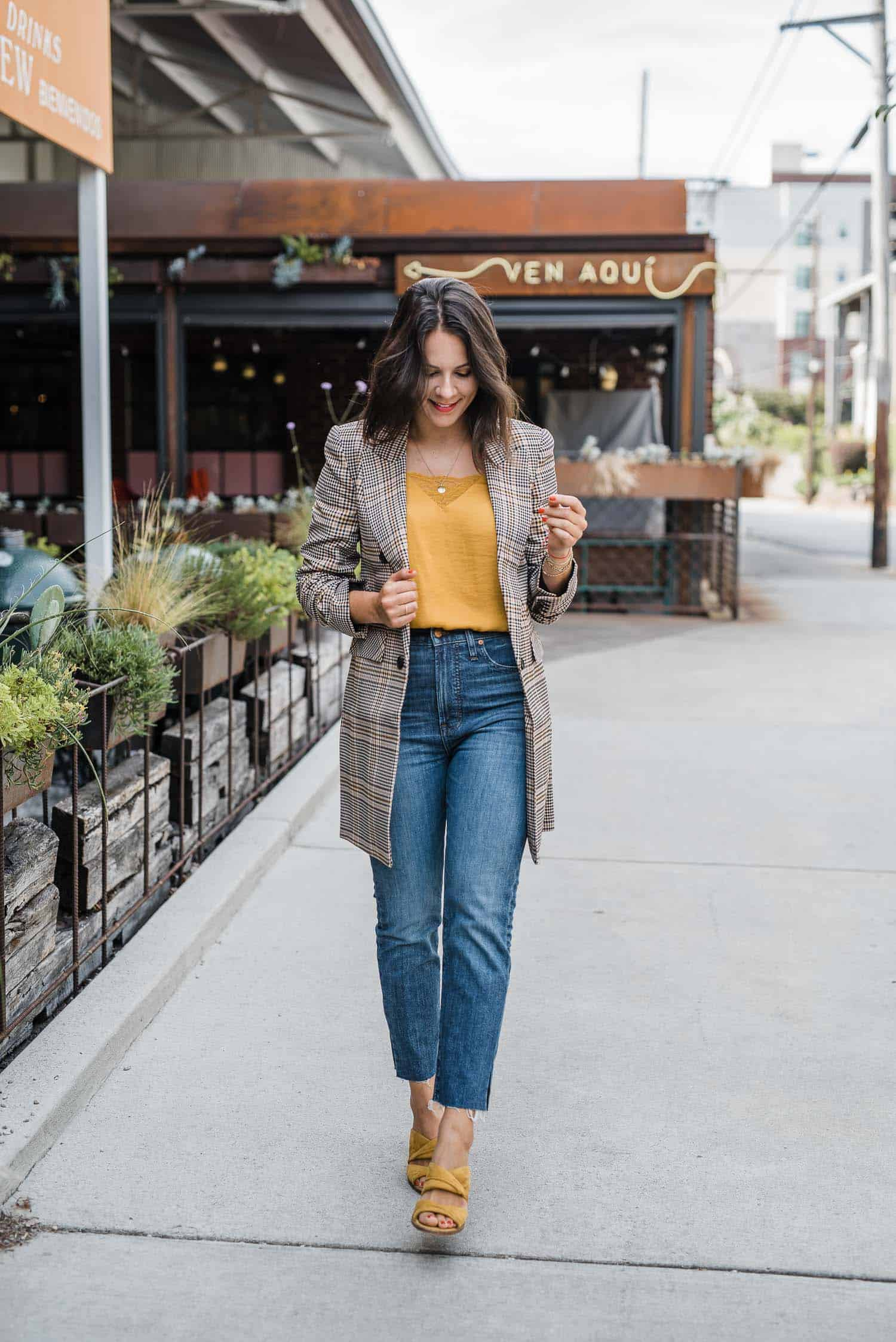 Jessica looks effortless in her blazer and mustard-colored top