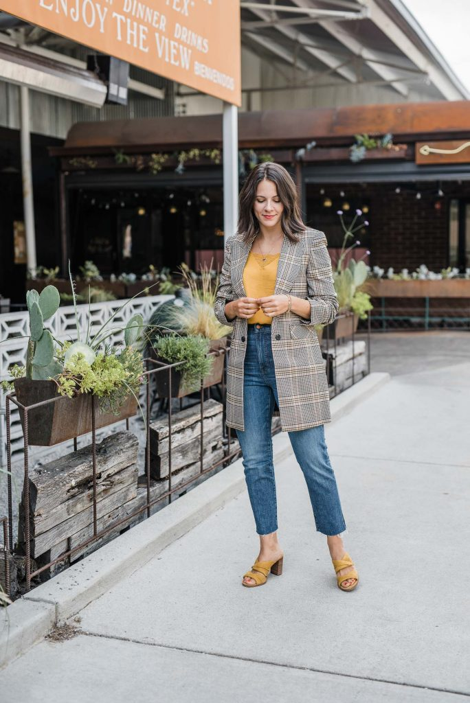 A flirty look in a mustard top and plaid blazer