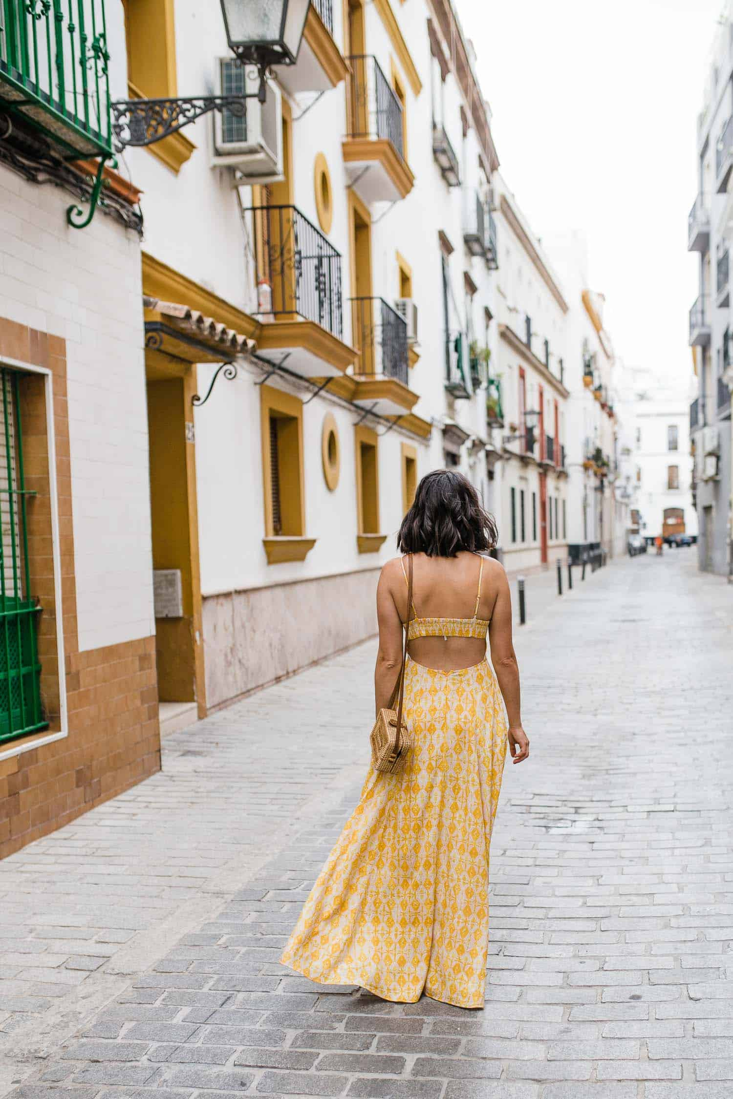 Jessica is wearing a printed Free People Milana maxi dress