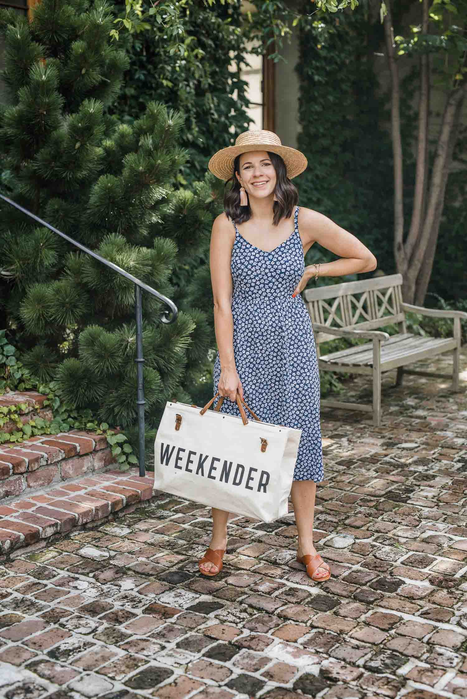 a big bag that says weekender