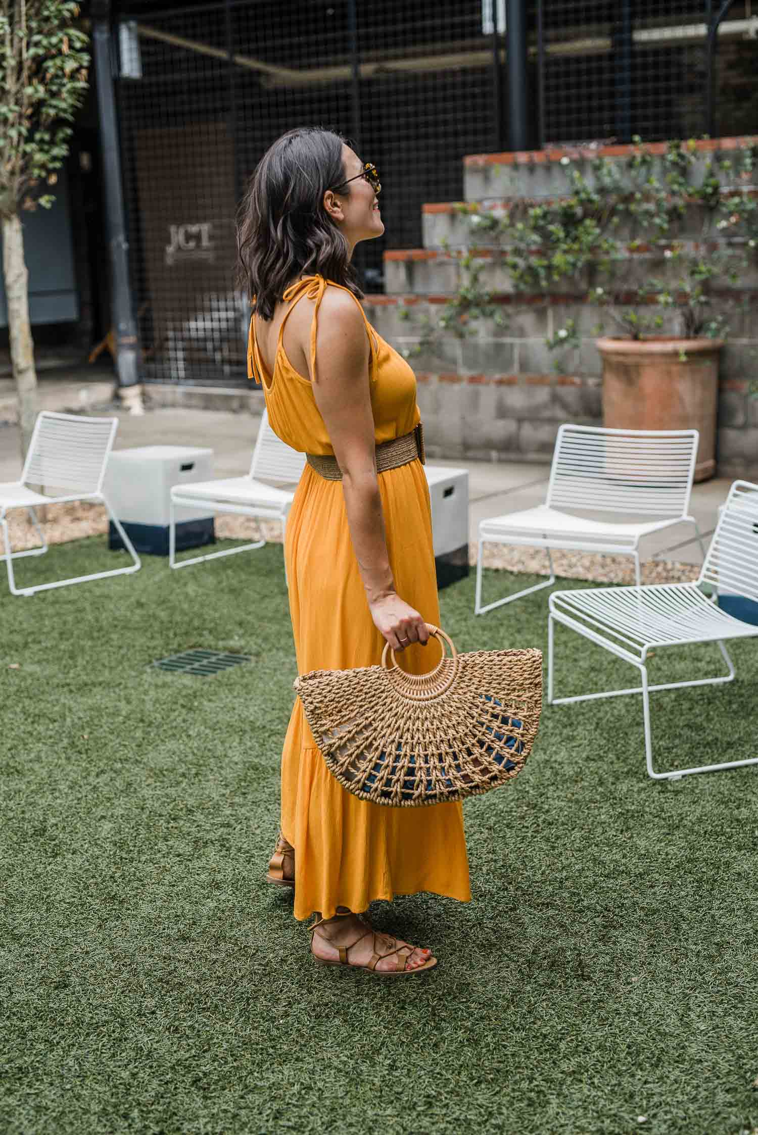 Jessica Camerata is sharing an orange maxi dress