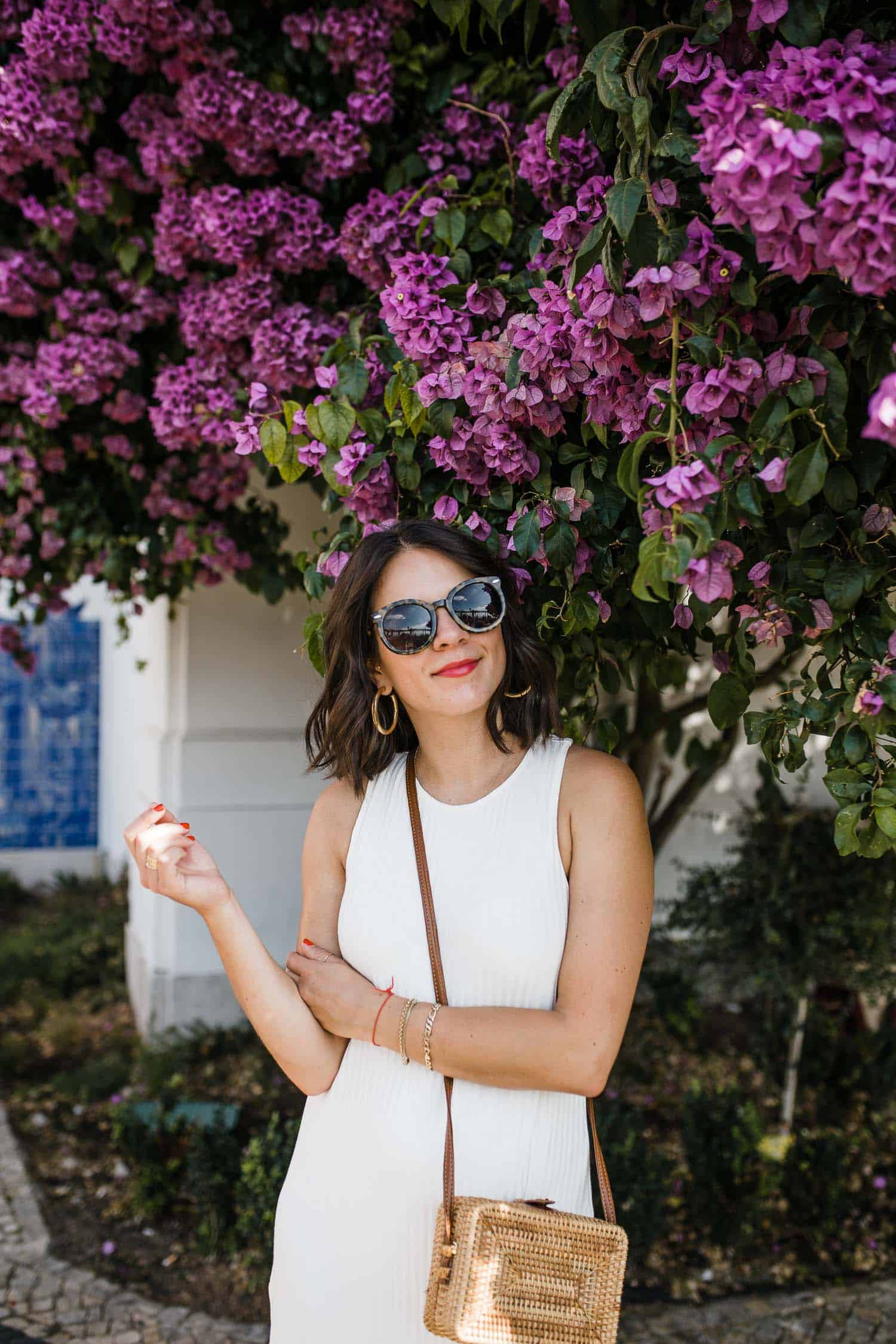 Instagrammable Spots In Lisbon with purple flowers in the background